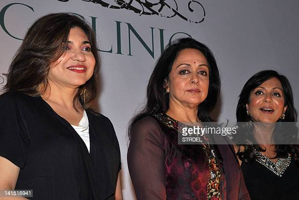 Indian Bollywood actress Hema Malini with playback singer Alka Yagnik and beauty specialist Sunita Banerji attend the launch of a cosmetology clinic...