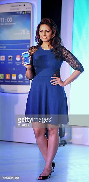 Indian Bollywood actress Huma Qureshi poses during the Launch of the new Samsung Galaxy smartphone in Mumbai on December 23 2013 AFP PHOTO/STR