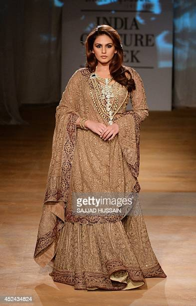 Indian Bollywood actress Huma Qureshi presents a creation by Indian fashion designers Rimple and Harpreet Narula during the India Couture Week 2014...