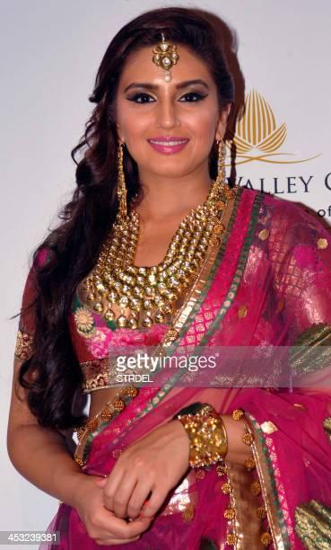 Indian Bollywood actress Huma Qureshi showcases a creation by designer Ashima Leena during the Aamby Valley India Bridal Fashion Week 2013 in Mumbai...