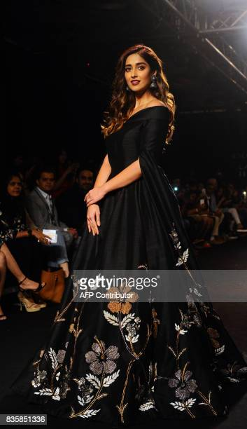 Indian Bollywood actress Ileana D'Cru showcases a creation by designer De Belle at the Lakme Fashion Week Winter/Festive 2017 in Mumbai on August 20...