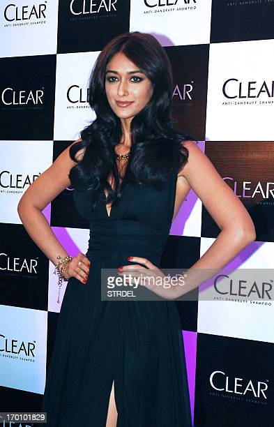 Indian Bollywood actress Ileana D'Cruz poses during the launch of CLEAR new range of shampoo in Mumbai on June 6 2013 AFP PHOTO/STR