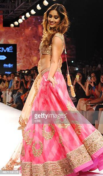 Indian Bollywood actress Ileana D'cruz showcases a creation by designer Anushree Reddy on the fourth day of the Lakme Fashion Week summer/resort 2015...