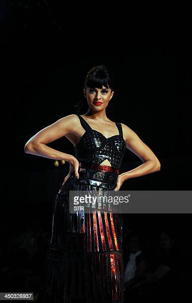 Indian Bollywood actress Jacqueline Fernandez showcases a creation by designers Falguni and Shane Peacock during the Signature International Fashion...