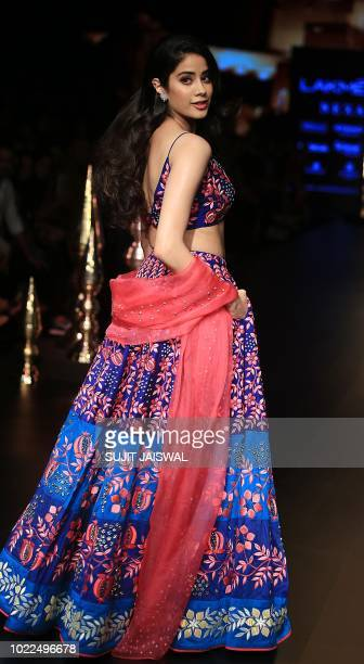 Indian Bollywood actress Jhanvi Kapoor showcases a creation by designer Nachiket Barve at the Lakmé Fashion Week Winter Festive 2018 in Mumbai on...