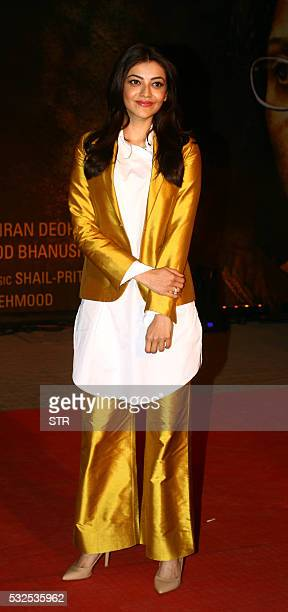 Indian Bollywood actress Kajal Aggarwal poses for a photograph during a promotional event for Hindi Film 'Sarabjit' in Mumbai on late May 18 2016 /...