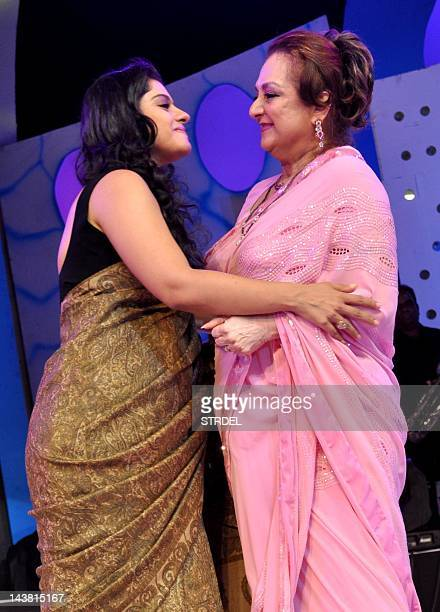 "Indian Bollywood actress Kajol and Saira Banu attend the ""143rd Dadasaheb Phalke Academy Awards 2012"" ceremony celebrating Indian Cinema in Mumbai on..."