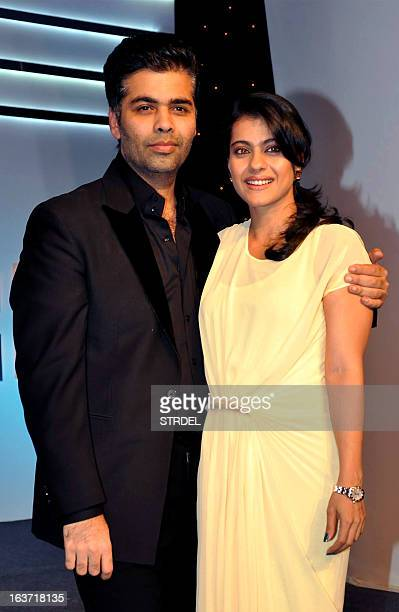 Indian Bollywood actress Kajol Devgan and film director Karan Johar pose for a photo at the Ficci Frames 2013 annual conclave of the media and...