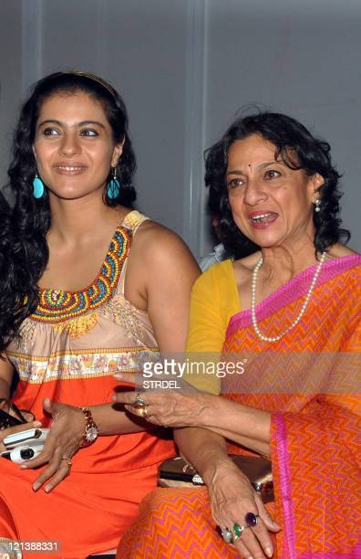 Indian Bollywood actress Kajol Devgan and her mother Tanuja Mukherjee attend a show on the fourth day of Lakme Fashion Week Winter/Festival 2011 in...