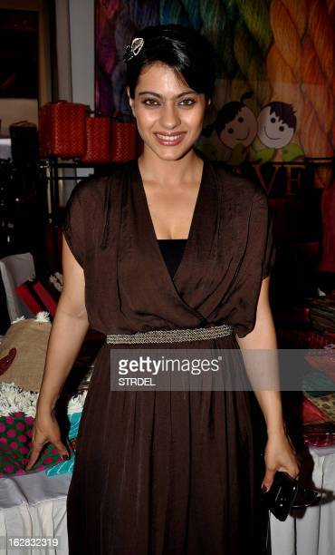 Indian Bollywood actress Kajol Devgan attends an exhibition by the Save The Children Foundation in Mumbai on February 28 2013 AFP PHOTO/ STR