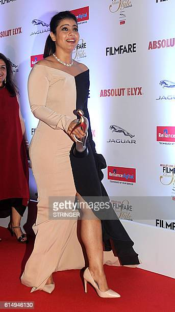 Indian Bollywood actress Kajol Devgan attends the 'Filmfare Glamour and Style Awards 2016' in Mumbai on October 15 2016 / AFP / STRINGER