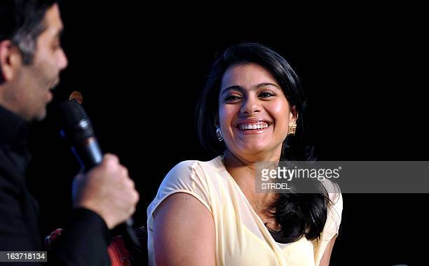 Indian Bollywood actress Kajol Devgan laughs at the Ficci Frames 2013 annual conclave of the media and entertainment industry in Mumbai on March 14...