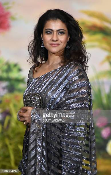 Indian Bollywood actress Kajol Devgan poses for a picture during the wedding reception of actress Sonam Kapoor and businessman Anand Ahuja in Mumbai...