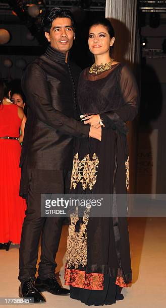 Indian Bollywood actress Kajol Devgan poses with designer Manish Malhotra during the Lakme Fashion Week Winter/Festival 2013 in Mumbai on August 22...