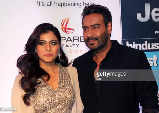 Indian Bollywood actress Kajol Devgn and actor Ajay Devgn pose as they attend the HT Most Stylish awards ceremony in Mumbai late March 24 2017 PHOTO...