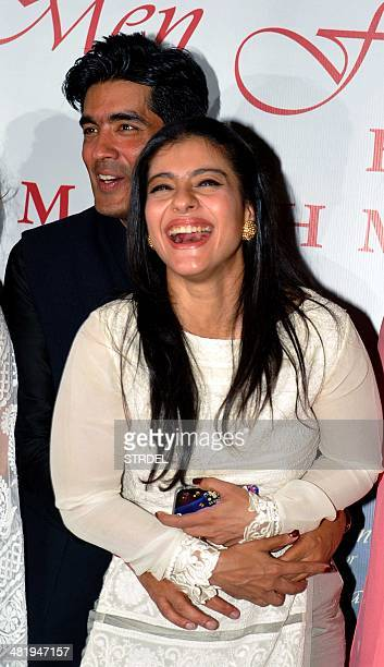 Indian Bollywood actress Kajol Devgn and designer Manish Malhotra pose for a photograph during a charity fashion show in Mumbai on late April 1 2014...