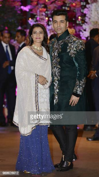 Indian Bollywood actress Kajol Devgn and directorproducer Karan Johar pose for a picture as they attend the preengagement party of India's richest...