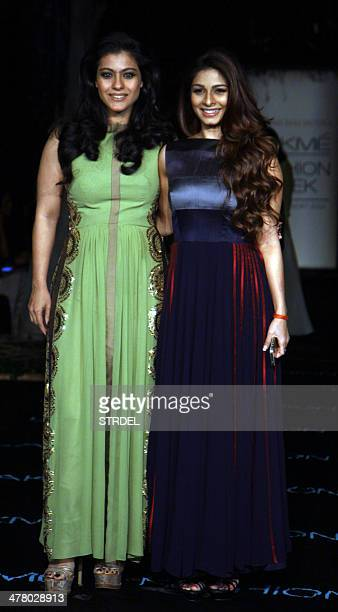 Indian Bollywood actress Kajol Devgn and her sister actress Tanisha Mukherjee pose for a photograph on the first day of the Lakme Fashion Week...