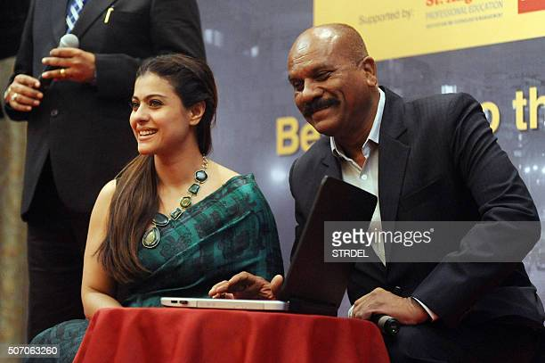 Indian Bollywood actress Kajol Devgn and retired Mumbai assistant commissioner of police Vasant Dhoble look on during a promotional event in Mumbai...