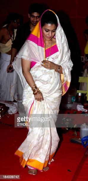 Indian Bollywood actress Kajol Devgn looks on at the North Bombay Sarbojanin Durga Puja Charitable trust festival in Mumbai on October 10 2013 AFP...