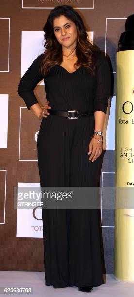 Indian Bollywood actress Kajol Devgn poses during a product launch in Mumbai on November 16 2016 / AFP / STRINGER