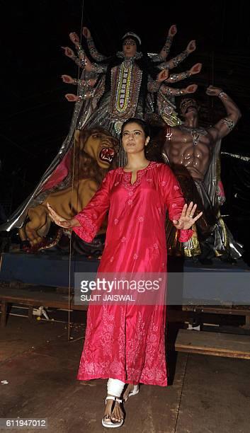 Indian Bollywood actress Kajol Devgn poses during unveiling an idol for North Bombay Sarbojanin Durga Puja Samiti 2016 at pandal in Mumbai on October...