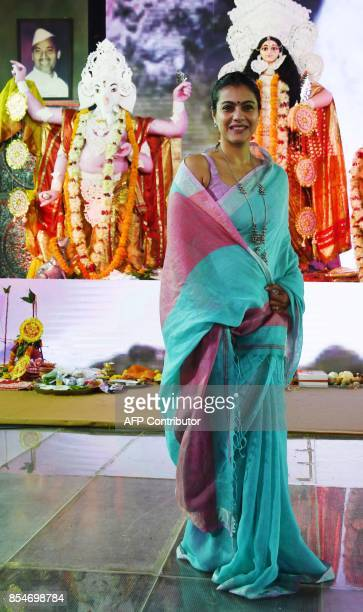 Indian Bollywood actress Kajol Devgn poses for a photo during 'Durja Puja' celebrations in the North Bombay Sarbojanin Durga Puja Samiti in Mumbai on...