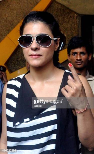 Indian Bollywood actress Kajol Devgn poses for a photograph after voting at a polling station in Mumbai on April 24 2014 India's 814millionstrong...