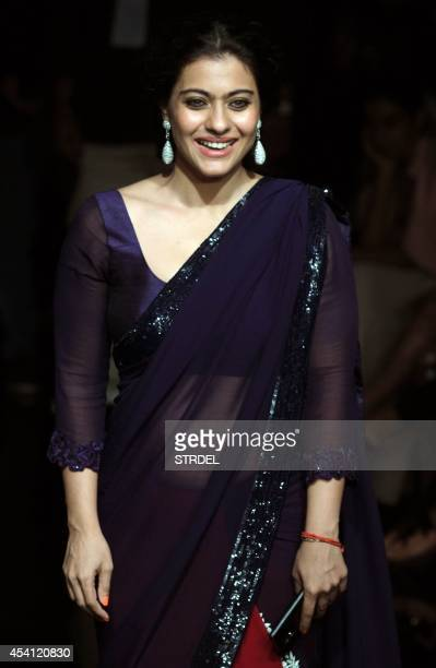 Indian Bollywood actress Kajol Devgn poses for a photograph during the final night of the Lakme Fashion Week Winter/Festival 2014 in Mumbai on late...