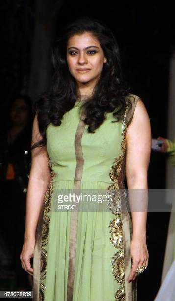 Indian Bollywood actress Kajol Devgn poses for a photograph on the first day of the Lakme Fashion Week Summer/Resort 2014 in Mumbai on late March 11...