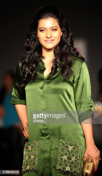 Indian Bollywood actress Kajol Devgn poses for a photograph on the fifth day of the Lakme Fashion Week summer/resort 2014 in Mumbai on March 15,...
