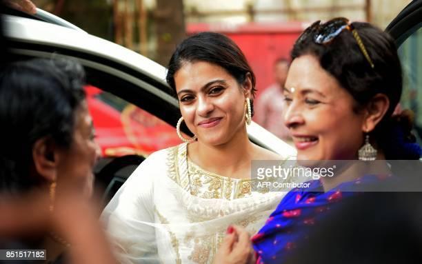 Indian Bollywood actress Kajol Devgn smiles during an event to unveil a 'Maa Durga' idol in Mumbai on September 22 2017 / AFP PHOTO / STR