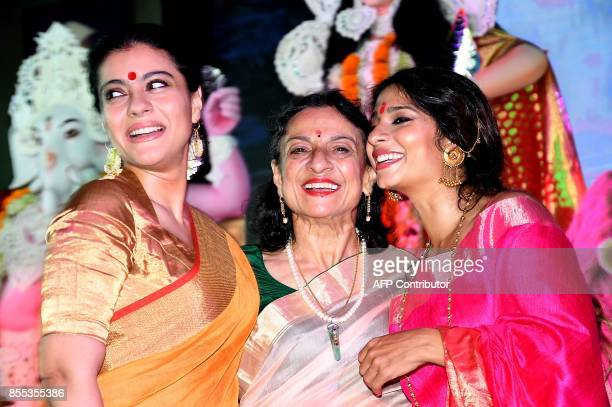 Indian Bollywood actress Kajol Devgn Tanuja Mukherjee and Tanish Mukherjee attend celebrations for the Hindu Durga Puja festival in Mumbai on...