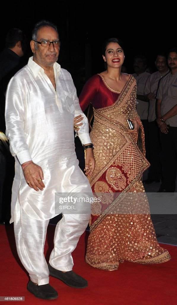 Indian Bollywood Actress Kajol Devgn With Father In Law Veeru Attend The Wedding Reception