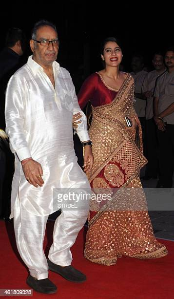 Indian Bollywood actress Kajol Devgn with father inlaw Veeru Devgn attend the wedding reception of Kussh Sinha son of Bollywood veteran actor...