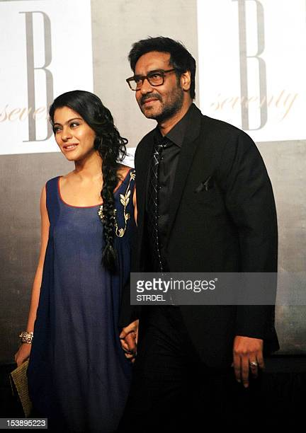 Indian Bollywood actress Kajol with husband Ajay Devgn pose as they attend the 70th Birthday celebrations of Bollywood Actor Amitabh Bachchan in...