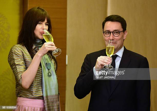 Indian Bollywood actress Kalki Koechlin and France's ambassador to India Alexandre Ziegler attend a ceremony to bestow Koechlin with the French...