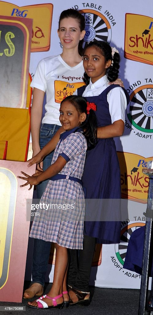 Indian Bollywood actress Kalki Koechlin poses with school