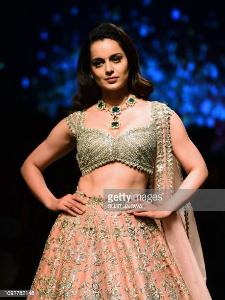Indian Bollywood actress Kangana Ranaut showcases a creation by designer Anushree Reddy at the Lakmé Fashion Week Summer Resort 2019 in Mumbai on...