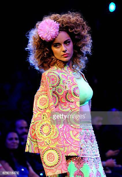 Indian Bollywood actress Kangana Ranaut showcases a creation by designer Manish Arora during the Blenders Pride Fashion Tour 2016 in Mumbai on...