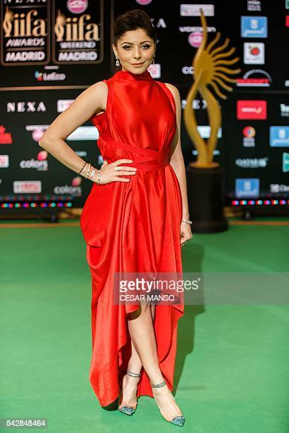 Indian Bollywood actress Kanika Kapoor poses on the green carpet as she arrives to the 17th edition of IIFA Awards in Madrid on June 24 2016 The IIFA...