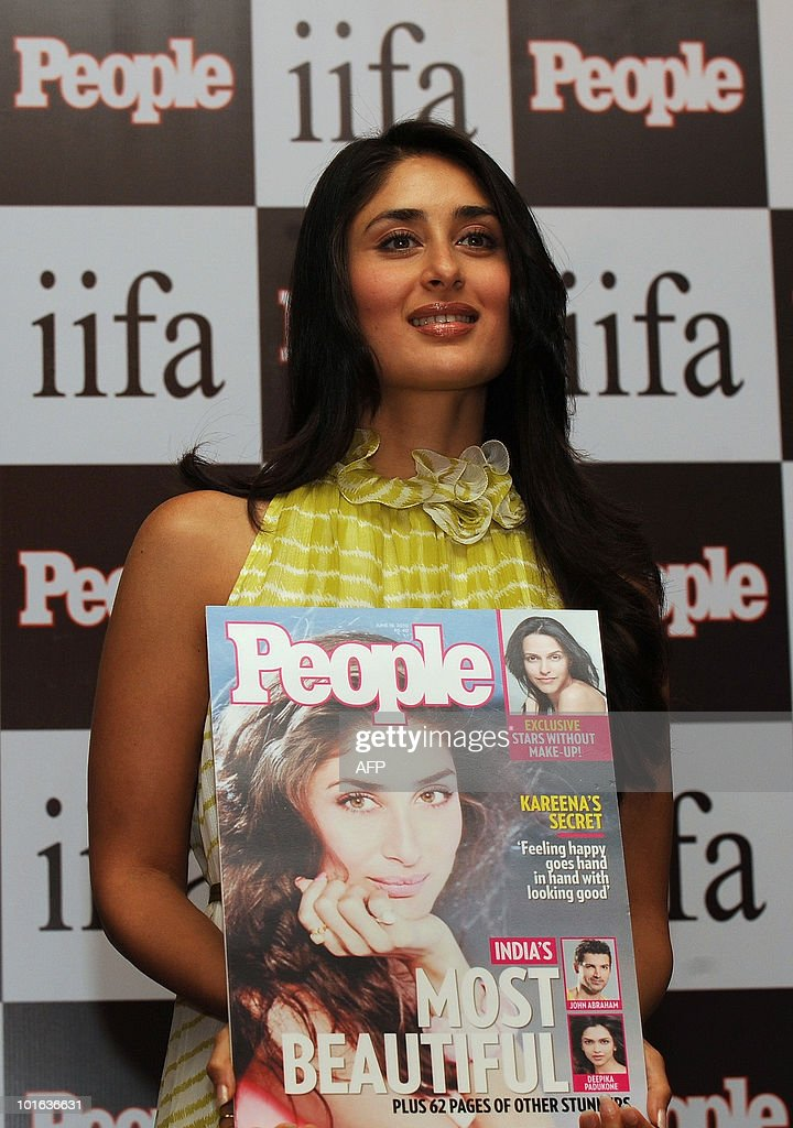Indian bollywood actress Kareena Kapoor displays a special issue of People magazine, at the International Indian Film Academy (IIFA) awards event in Colombo on June 5, 2010. Megastar Aamir Khan's hit movie '3 Idiots' is set to sweep the board at the 'Bollywood Oscars' in Sri Lanka this weekend, after scooping a string of awards in the technical categories. AFP PHOTO/Punit PARANJPE