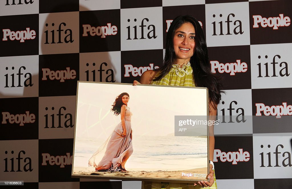 Indian bollywood actress Kareena Kapoor holds a picture showing herself during the launch of a special issue of People magazine, at the International Indian Film Academy (IIFA) awards event in Colombo on June 5, 2010. Megastar Aamir Khan's hit movie '3 Idiots' is set to sweep the board at the 'Bollywood Oscars' in Sri Lanka this weekend, after scooping a string of awards in the technical categories. AFP PHOTO/Punit PARANJPE
