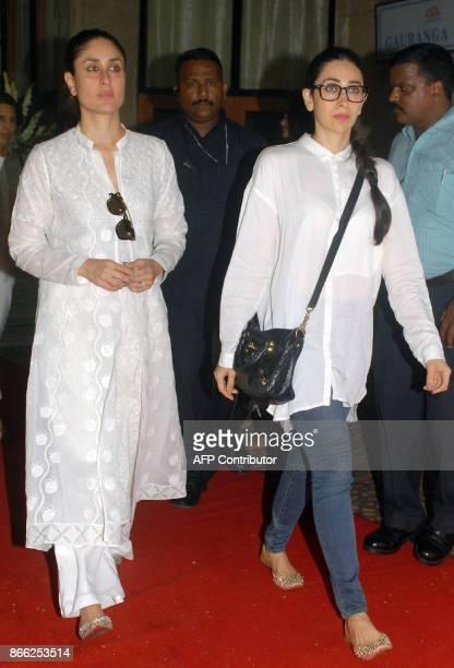 Indian Bollywood actress Kareena Kapoor Khan and Karishma Kapoor attend a prayer meeting for film director Ram Mukherjee in Mumbai on October 25 2017...