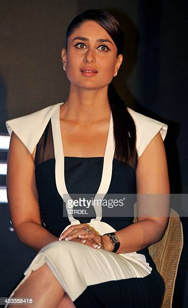Indian Bollywood actress Kareena Kapoor Khan looks on during a promotional event for the forthcoming Hindi film 'Singham Returns' directed by Rohit...