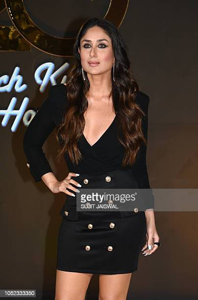 Indian Bollywood actress Kareena Kapoor Khan poses for a picture as they attend an event celebrating the 20th anniversary of the Hindi film 'Kuch...