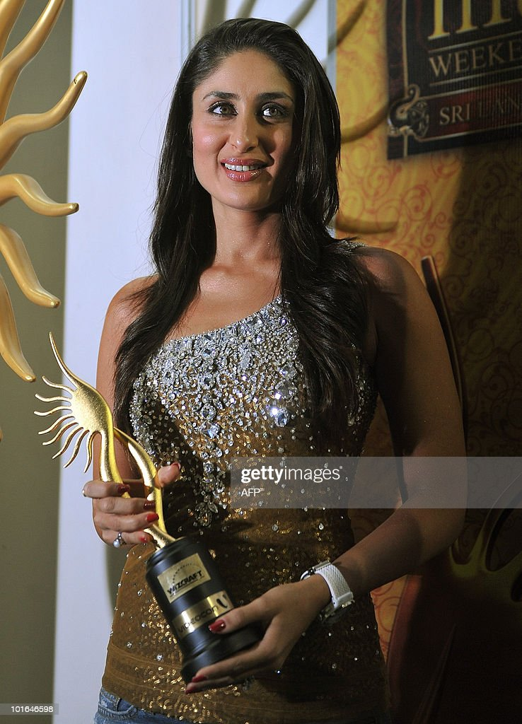 Indian Bollywood actress Kareena Kapoor poses with a trophy after winning the best female actress award at the International Indian Film Academy (IIFA) awards in Colombo on June 5, 2010. Bollywood actors arrived in Sri Lanka to attend the three-day International Indian Film Academy (IIFA) awards and surrounding events that begun in Colombo on June 3.