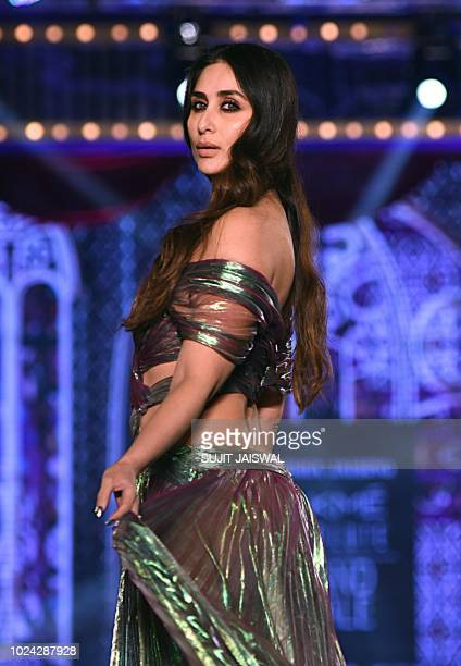 Indian Bollywood actress Kareena Kapoor showcases a creation by designer Monisha Jaising during the grand finale of Lakmé Fashion Week Winter/Festive...