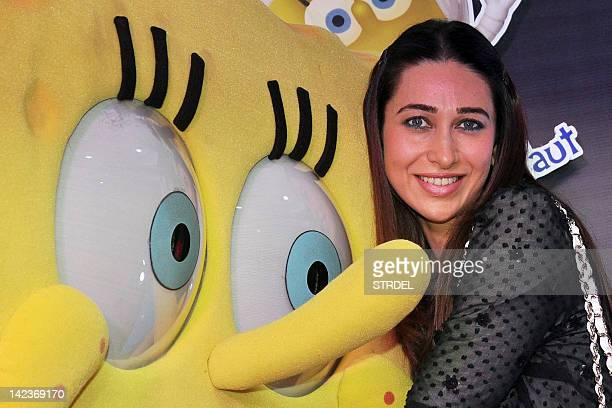 Indian Bollywood Actress Karishma Kapoor poses during the launch of the McDonald's SpongeBob SquarePants Happy Meal in Mumbai on April 3 2012 AFP...