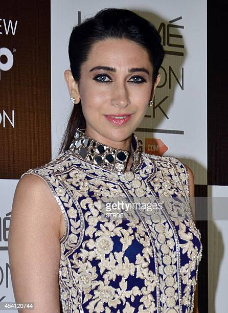 Indian Bollywood actress Karishma Kapoor poses for a photograph during the final night of the Lakme Fashion Week Winter/Festival 2014 in Mumbai on...